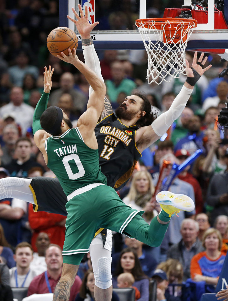 Photo - Oklahoma City's Steven Adams (12) defends Boston's Jayson Tatum (0) in the fourth quarter during an NBA basketball game between the Oklahoma City Thunder and the Boston Celtics at Chesapeake Energy Arena in Oklahoma City, Sunday, Feb. 9, 2020. Boston won 112-111. [Nate Billings/The Oklahoman]