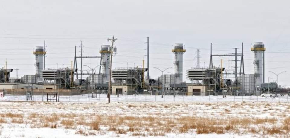Photo -  Natural gas turbine units at Oklahoma Gas and Electric Co.'s Mustang Power Plant in west Oklahoma City were busy putting energy onto the grid serving much of Oklahoma as part of the Southwest Power Pool during last week's storm. [Chris Landsberger/The Oklahoman]