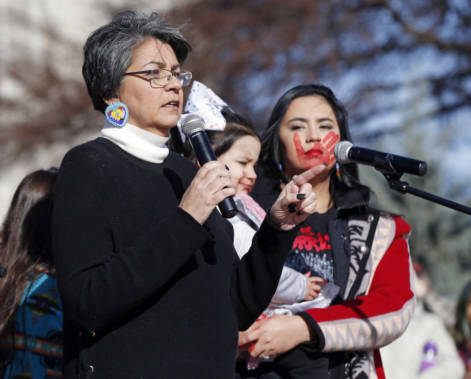 Photo - Olivia Gray, director of the Osage Nation Family Violence Prevention Department, speaks during the 2019 Women's March Oklahoma City at the state Capitol in Oklahoma City, Sunday, Jan. 20, 2019. Photo by Nate Billings, The Oklahoman
