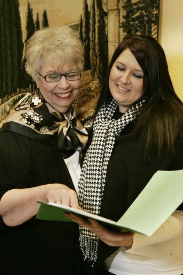 Photo -  In this photo from 10 years ago, Judy Lindsay, 2009 president of the Oklahoma City Metro Association of Realtors, looks over paperwork with her daughter, Becky Karpe, who would become the 2019 president. Lindsay died in a car wreck on July 4. [THE OKLAHOMAN ARCHIVES]