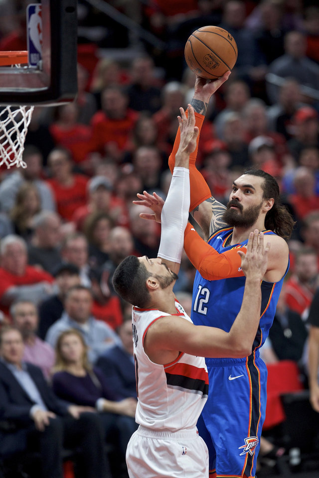 Photo - Oklahoma City Thunder center Steven Adams, right, shoots over Portland Trail Blazers center Enes Kanter during the first half of Game 2 of an NBA basketball first-round playoff series Tuesday, April 16, 2019, in Portland, Ore. (AP Photo/Craig Mitchelldyer)