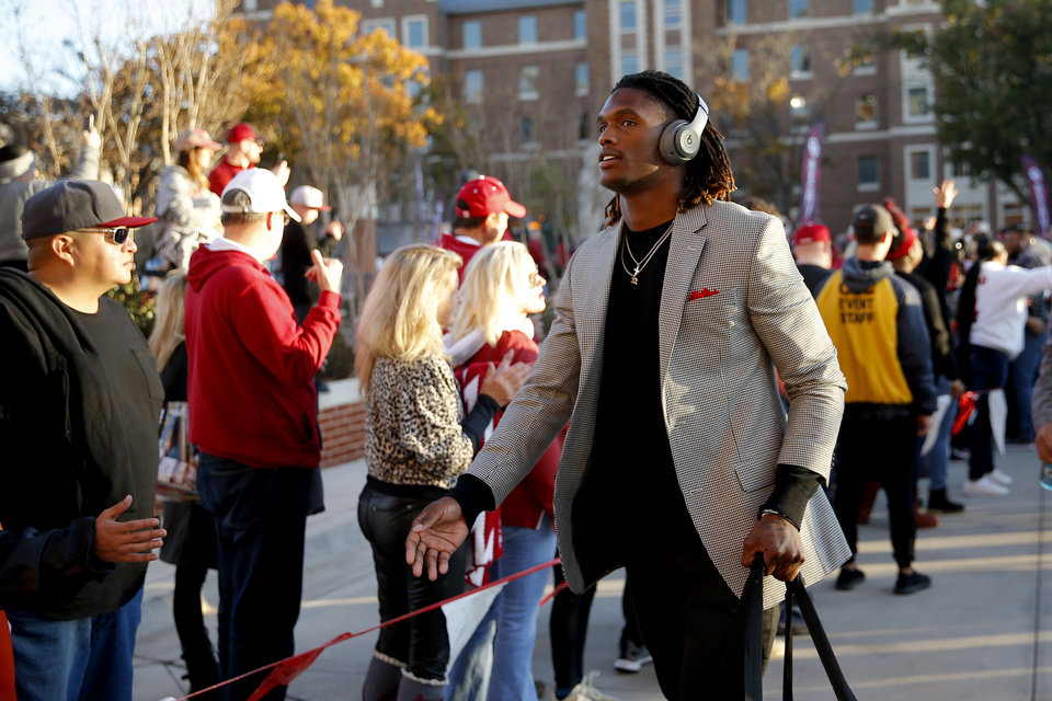 Photo - Oklahoma's CeeDee Lamb arrives before an NCAA football game between the University of Oklahoma Sooners (OU) and the Iowa State University Cyclones at Gaylord Family-Oklahoma Memorial Stadium in Norman, Okla., Saturday, Nov. 9, 2019. [Bryan Terry/The Oklahoman]