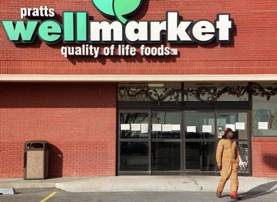 Photo - A Guthrie, Okla., resident turns away from Pratts Wellmarket in Edmond, Okla., after discovering the