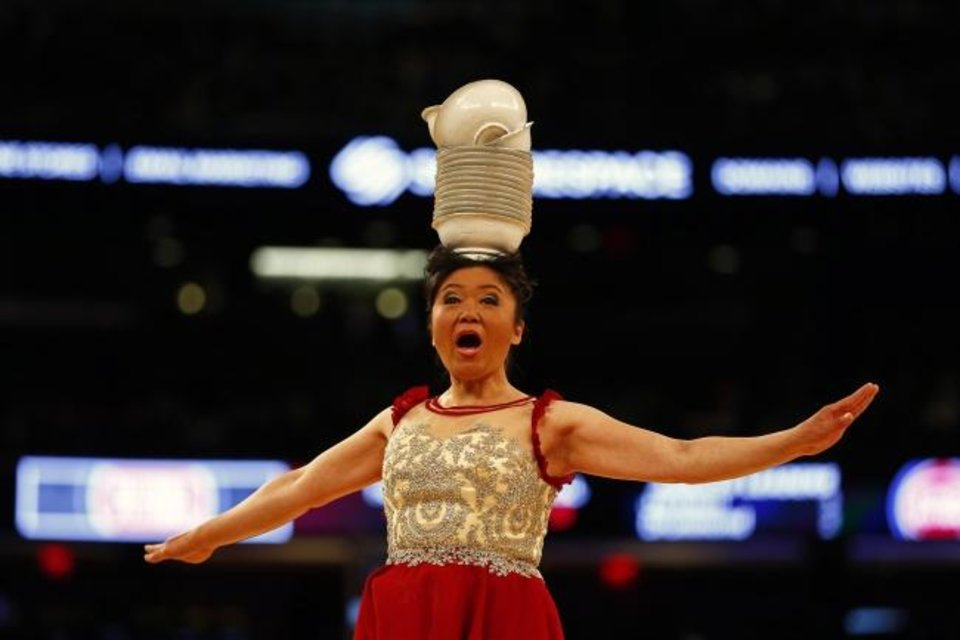 Photo -  Acrobat and performer Krystal Niu, better known as Red Panda, has been performing at NBA games since 1993. [Adam Hunger/USA TODAY Sports]