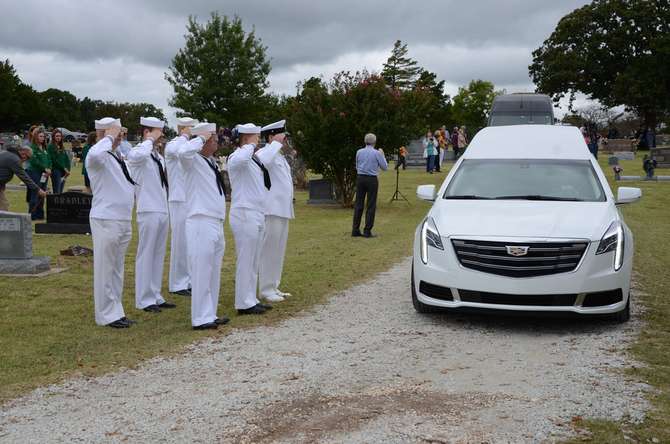 Photo -  The hearse carrying the remains of James Cecil Webb reaches Dale Cemetery.