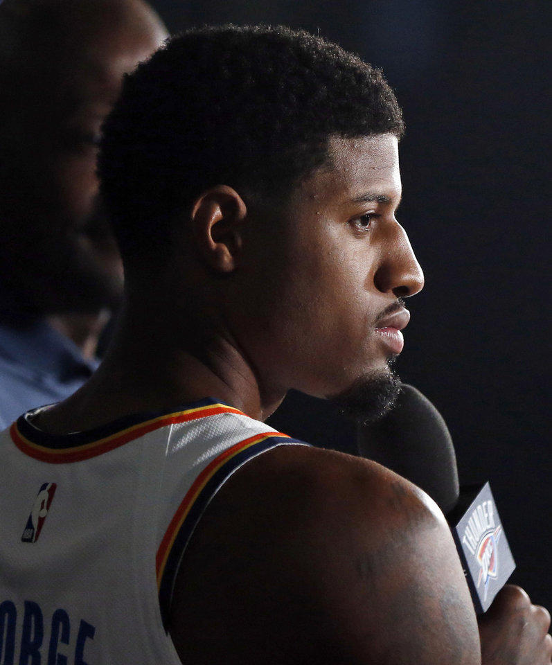 Photo - Paul George listens during an interview at media day for the Oklahoma City Thunder at Chesapeake Energy Arena in Oklahoma City, Monday, Sept. 24, 2018. Photo by Nate Billings, The Oklahoman