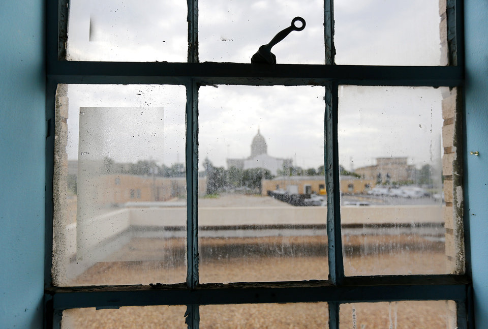 Photo - Looking out toward the Capitol from a west window on the second floor of the armory. COOP Ale Works announced Tuesday morning, July 17, 2018, that their proposal to acquire and redevelop the 23rd Street Armory has been accepted by the Oklahoma Office of Management and Enterprise Services. The 87,000  square-foot brick structure near NE 23 and Lincoln will be purchased by COOP for $600,000 and the company plans to return the building to its former glory with updates to the interior, transforming it into a bustling brewery production floor, full service restaurant , a 22-room boutique hotel, offices and meeting rooms. COOP officials indicated they plan to dedicate $20 million to the overall project. Photo by Jim Beckel, The Oklahoman