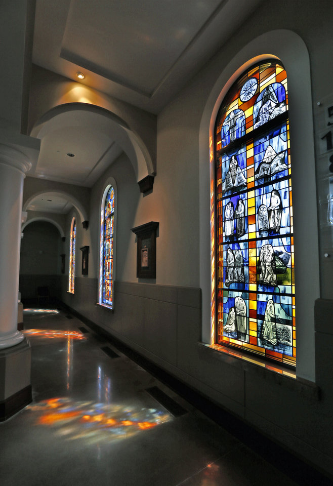 Photo -  Stained glass windows at St. Eugene Catholic Church depicts scene from the life of three individuals recognized as martyrs by the Catholic Church, including the late Rev. Stanley Rother. [Photo by Steve Sisney The Oklahoman]