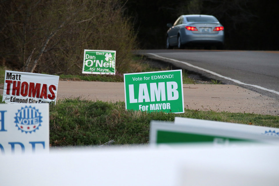 Photo - Election signs on the side of the road near Coltrane and Covell. Voting in Edmond, Tuesday, April 2, 2019.  Photo by Doug Hoke/The Oklahoman