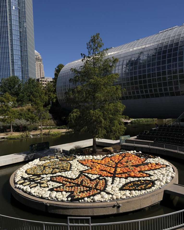 Photo - Local artist Nick Bayer's giant pumpkin mosaic on the Myriad Gardens Water Stage for the Myriad Gardens Great Pumpkin Patch is seen on Monday, October 12, 2020. [Doug Hoke/The Oklahoman]