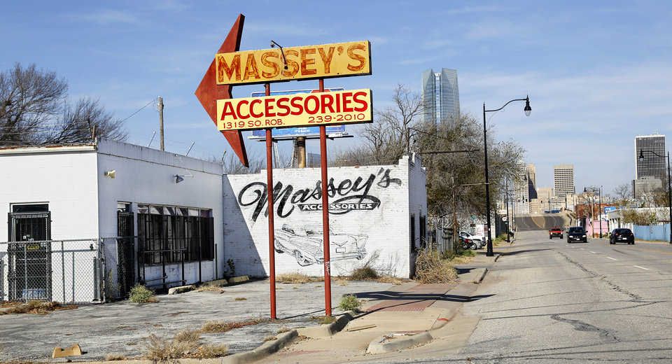 Photo -  The lower section of the MAPS 3 downtown park will supplant the automotive parts and supply businesses in Hubcap Alley along S Robinson Avenue. [Photo by Jim Beckel, The Oklahoman]