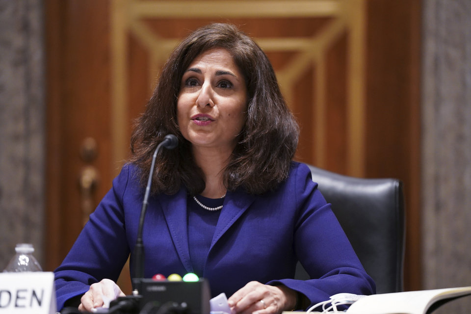 Photo -  Neera Tanden testifies before the Senate Homeland Security and Government Affairs committee on her nomination to become the Director of the Office of Management and Budget (OMB), during a hearing Tuesday, Feb. 9, 2021 on Capitol Hill in Washington.  (Leigh Vogel/Pool via AP)