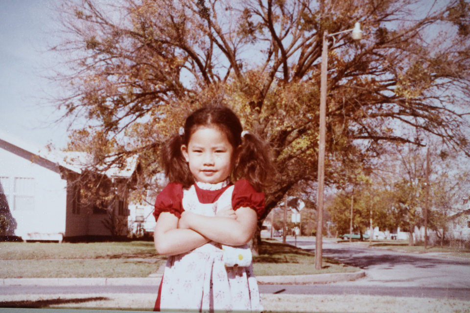 Photo -  In this photo taken in an Oklahoma City neighborhood, Vi Le is shown at age 4 or 5. [Photo provided]