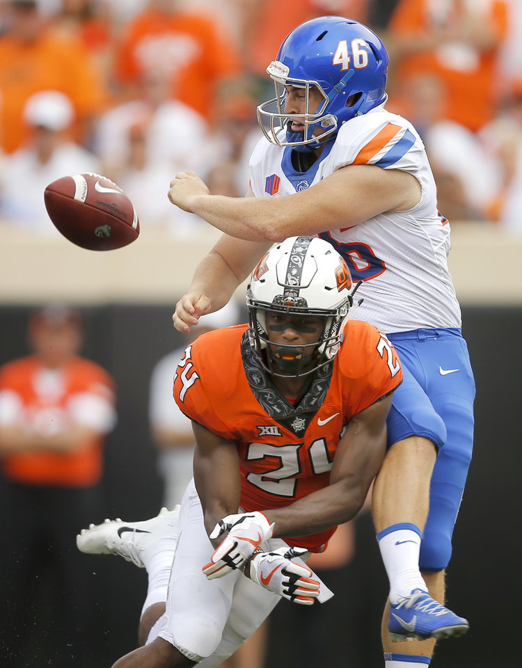 Photo - Oklahoma State's Jarrick Bernard (24) blocks the punt of Boise State's Joel Velazquez (46) during a college football game between the Oklahoma State University Cowboys (OSU) and the Boise State Broncos at Boone Pickens Stadium in Stillwater, Okla., Saturday, Sept. 15, 2018. Oklahoma State won 44-21. Photo by Bryan Terry, The Oklahoman