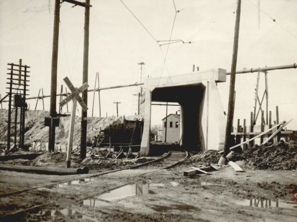 Photo -  This 1932 photograph shows an overpass contractors installed for the Santa Fe's elevated tracks across tracks used by the Rock Island and Frisco lines. [OKLAHOMAN ARCHIVES]