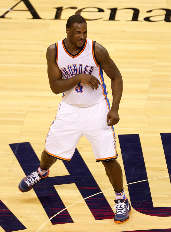 Photo - Oklahoma City's Dion Waiters (3) celebrates during Game 3 of the Western Conference finals in the NBA playoffs between the Oklahoma City Thunder and the Golden State Warriors at Chesapeake Energy Arena in Oklahoma City, Sunday, May 22, 2016. Photo by Sarah Phipps, The Oklahoman