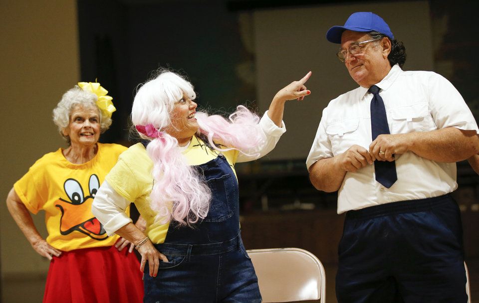 Photo -  From left, Sylvia Frank, Susan Hause and Dean Gaston of Oklahoma Seniors Cabaret rehearse Monday at Messiah Lutheran Church in Oklahoma City. [Photo by Nate Billings, The Oklahoman]