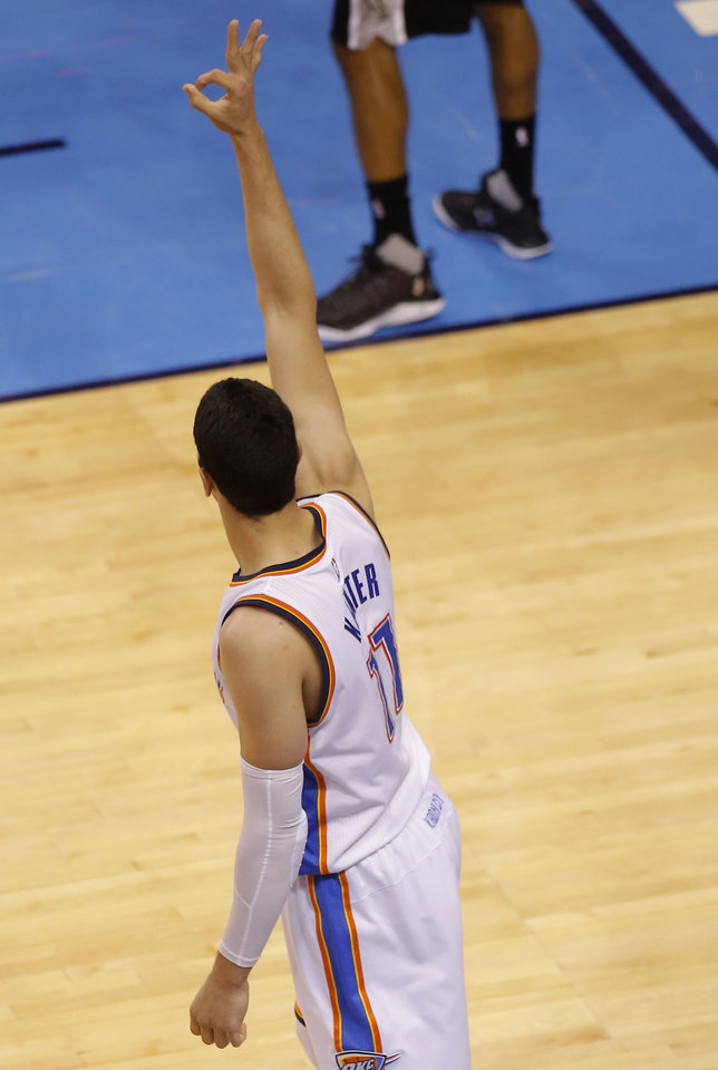 Photo - Oklahoma City's Enes Kanter (11) celebrates a 3-point basket during Game 4 of the Western Conference semifinals between the Oklahoma City Thunder and the San Antonio Spurs in the NBA playoffs at Chesapeake Energy Arena in Oklahoma City, Sunday, May 8, 2016. Photo by Sarah Phipps, The Oklahoman