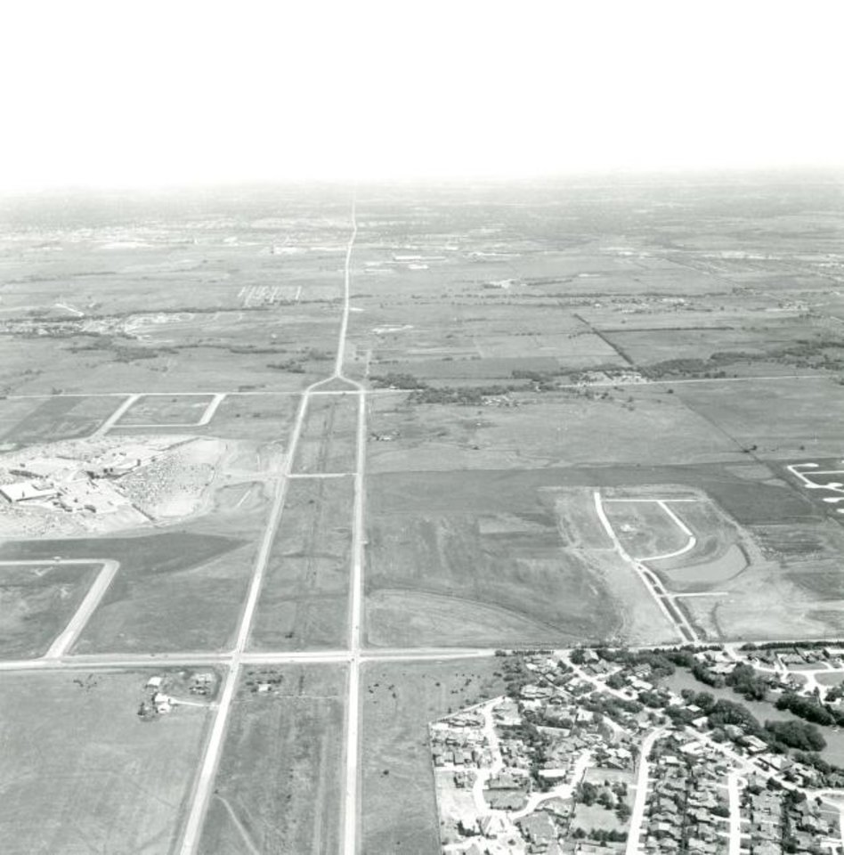 Photo -  Quail Springs Mall was surrounded by farmland with the closest housing, Quail Creek, shown in the lower right corner of this photo taken in 1981. The Kilpatrick Turnpike was built in the wide Memorial Road median that ended just east of the mall at Pennsylvania Avenue. [THE OKLAHOMAN ARCHIVES]