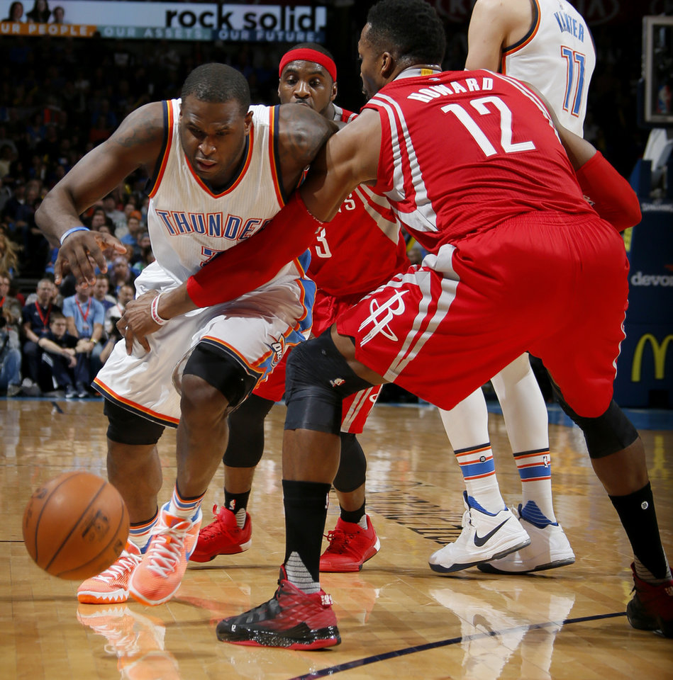 Photo - Oklahoma City's Dion Waiters (3) goes around Houston's Dwight Howard (12) during an NBA basketball game between the Oklahoma City Thunder and the Houston Rockets at Chesapeake Energy Arena in Oklahoma City, Friday, Jan. 29, 2016. Photo by Bryan Terry, The Oklahoman