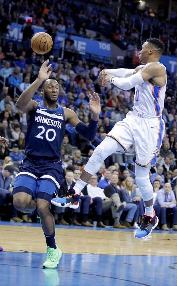 Photo - Oklahoma City's Russell Westbrook (0) passes the ball as Minnesota's Josh Okogie (20) defends during the NBA game between the Oklahoma City Thunder and Minnesota Timberwolves at the Chesapeake Energy Arena, Tuesday, Jan. 8, 2019. Photo by Sarah Phipps, The Oklahoman