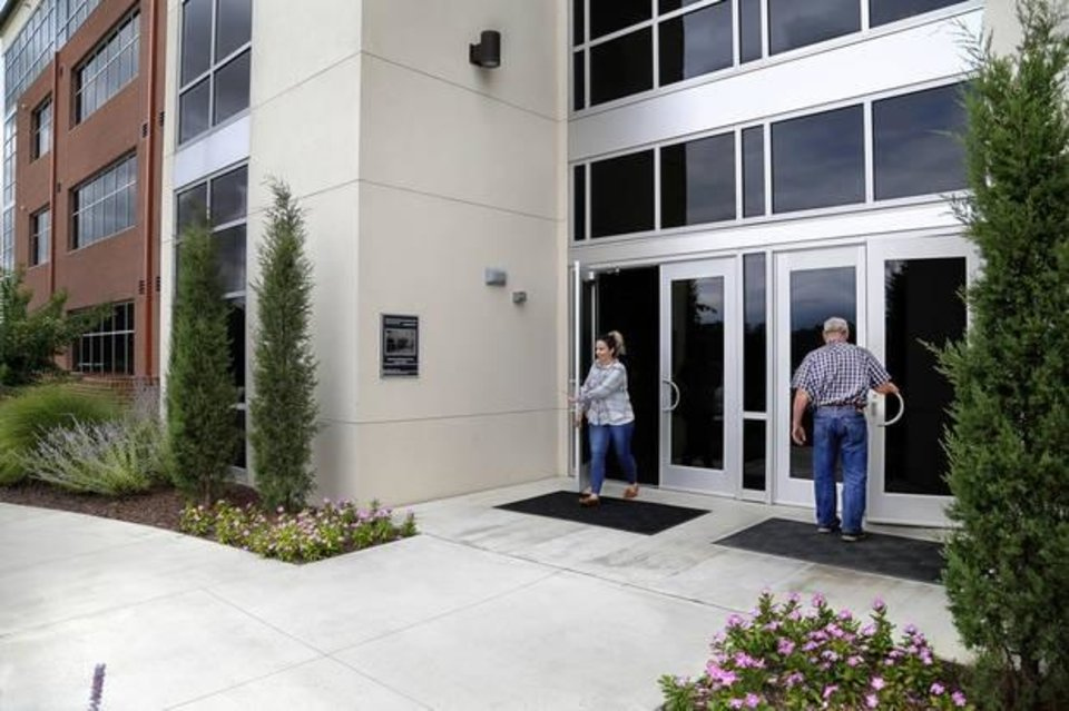Photo -  The front entrance to the headquarters of Gateway First in Jenks. [Jim Beckel for The Oklahoman]