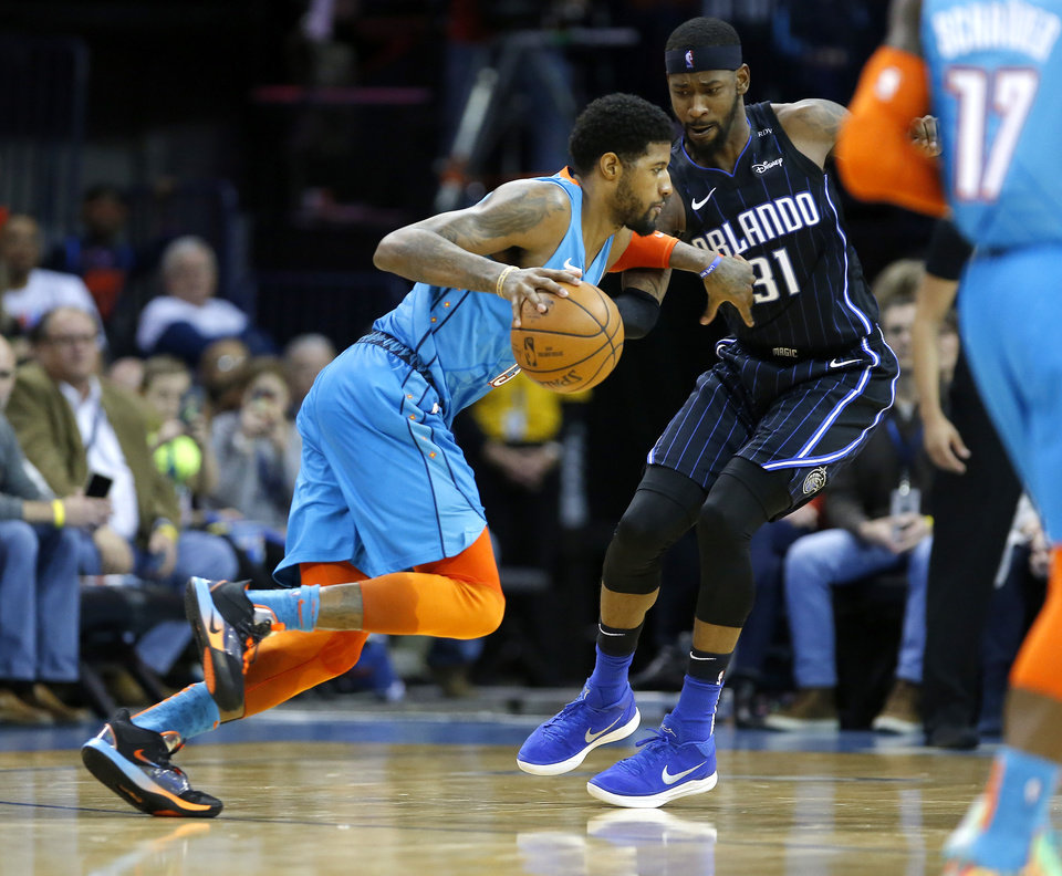 Photo - Oklahoma City's Paul George (13) tries to get by Orlando's Terrence Ross (31) during the NBA game between the Oklahoma City Thunder and the Orlando Magic at the Chesapeake Energy Arena  Tuesday, Feb. 5, 2019. Photo by Sarah Phipps, The Oklahoman