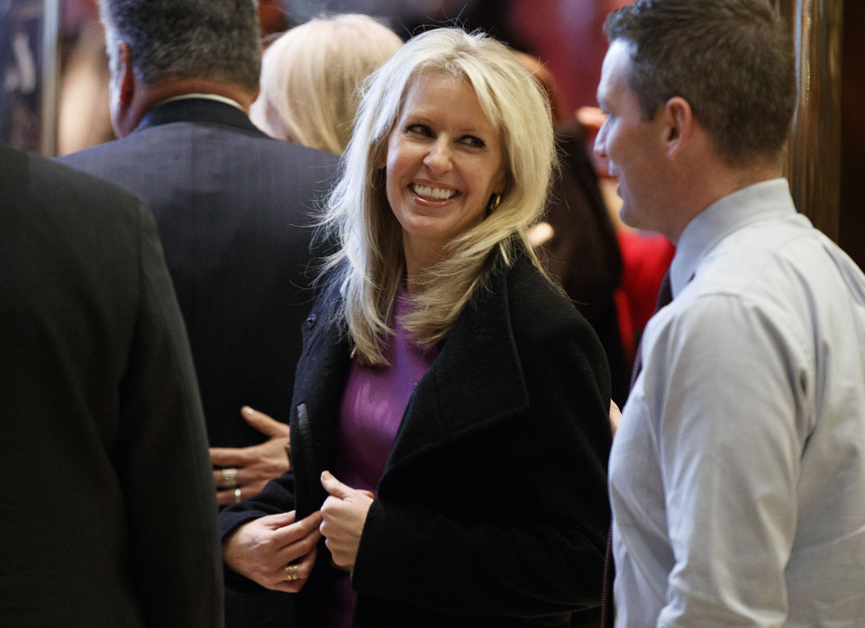 "Photo - FILE - This Dec. 15, 2016 file photo shows Monica Crowley in the lobby of Trump Tower in New York. The publisher of Crowley's ""What the (Bleep) Just Happened?"" said Tuesday, Jan. 10, 2017, it is halting sales of the book, pending the ""opportunity"" for the aide to President-elect Donald Trump to revise her text. She is accused of plagiarizing numerous passages in the 2012 book. (AP Photo/Evan Vucci, File)"