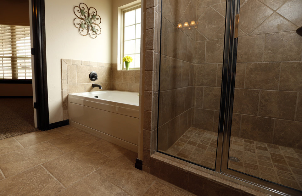 Spectacular This view shows the master bath of the home by First Oklahoma Construction at Boulevard Du Lac in Norman