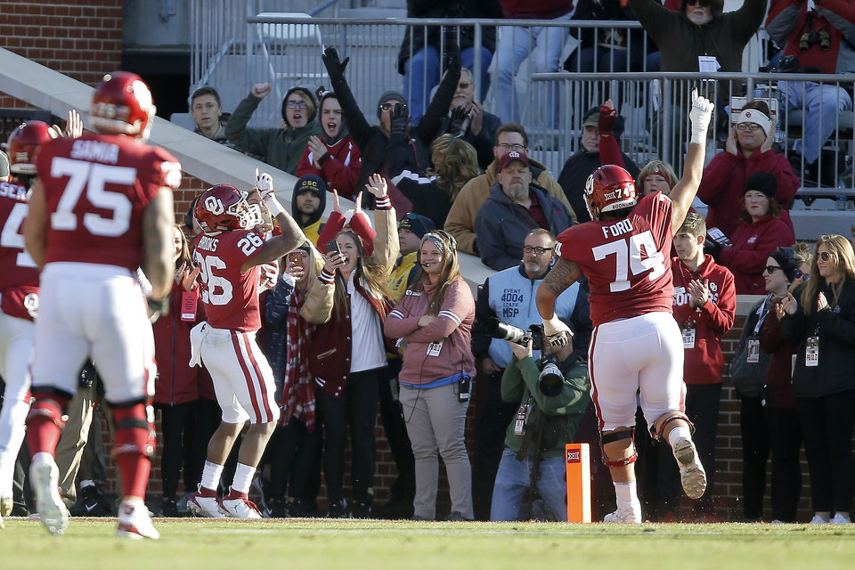 Photo - Oklahoma's Kennedy Brooks (26) celebrates after a touchdown during a Bedlam college football game between the University of Oklahoma Sooners (OU) and the Oklahoma State University Cowboys (OSU) at Gaylord Family-Oklahoma Memorial Stadium in Norman, Okla., Nov. 10, 2018.  Photo by Bryan Terry, The Oklahoman