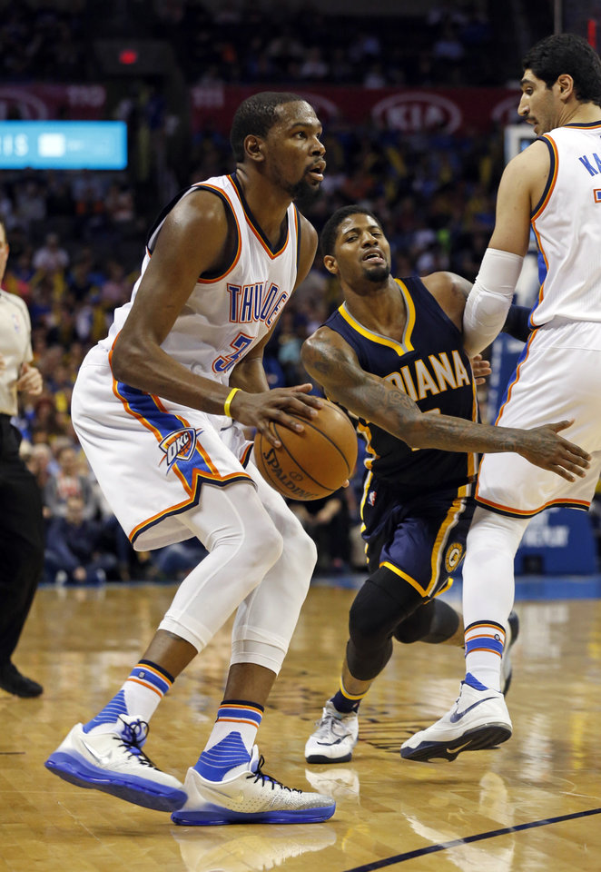 Photo - Oklahoma City Thunder's Kevin Durant (35) shoots behind a screen by Enes Kanter (11) in the second half of an NBA basketball game where the Oklahoma City Thunder lost to the Indiana Pacers 101-98 at the Chesapeake Energy Arena in Oklahoma City, on Feb. 19, 2016.  Photo by Steve Sisney The Oklahoman