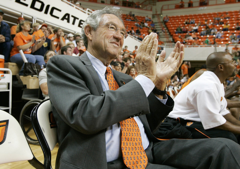 Photo - OSU BASKETBALL Coach Eddie Sutton claps during the three- point contest at Gallagher-Iba Arena Stillwater, October 14, 2005. By Steve Gooch/The Oklahoman.