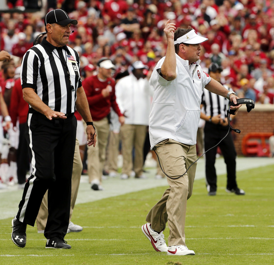 Photo - Oklahoma head coach Bob Stoops wants and gets an intentional grounding call during a college football game between the University of Oklahoma Sooners (OU) and the Texas Tech Red Raiders at Gaylord Family-Oklahoma Memorial Stadium in Norman, Okla., on Saturday, Oct. 24, 2015. Photo by Steve Sisney, The Oklahoman