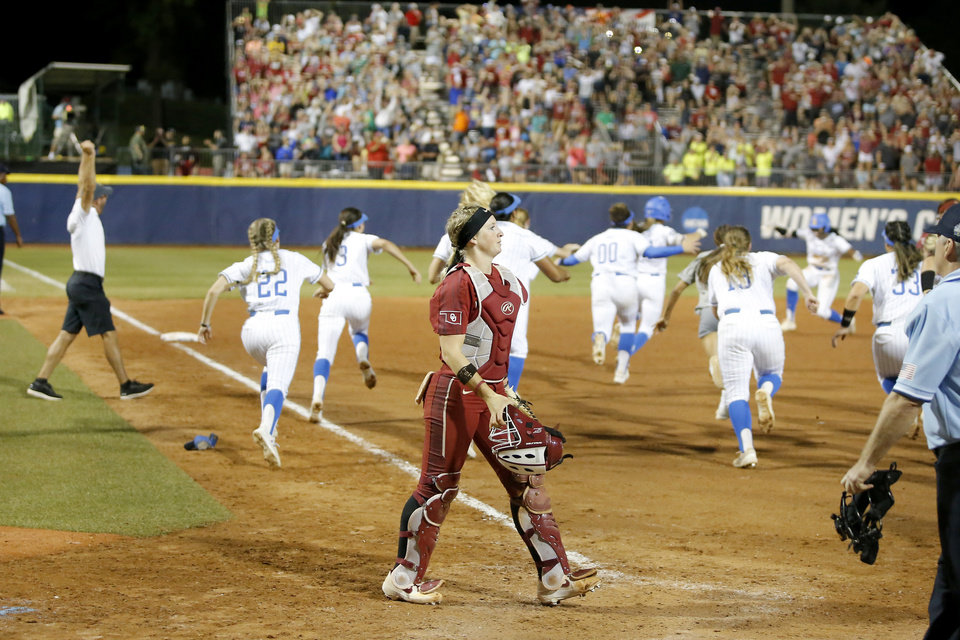 Photo - Oklahoma's Lynnsie Elam (22) walks off the field after OU's in the second NCAA softball game in the championship series of the Women's College World Series between Oklahoma and UCLA at USA Softball Hall of Fame Stadium in Oklahoma City, Tuesday, June 4, 2019. UCLA won 5-4. [Bryan Terry/The Oklahoman]