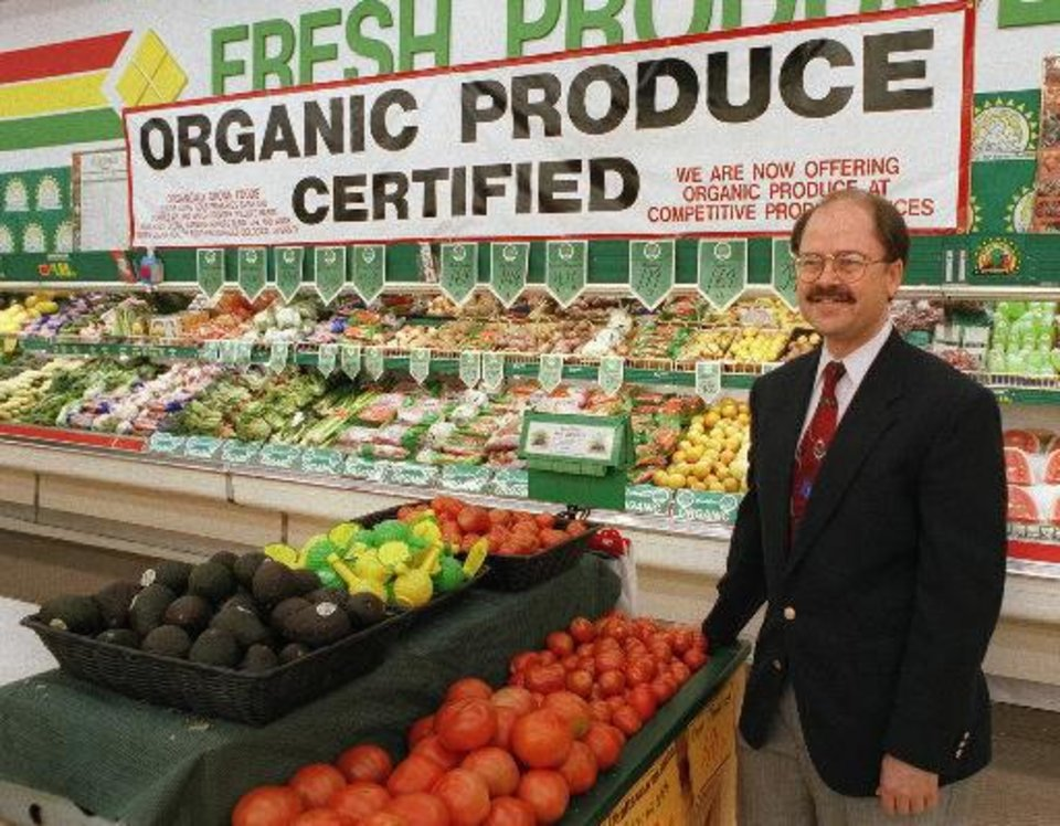 Photo - J.B. Pratt is shown in his store's organic produce section in this 2001 photo.  Archives