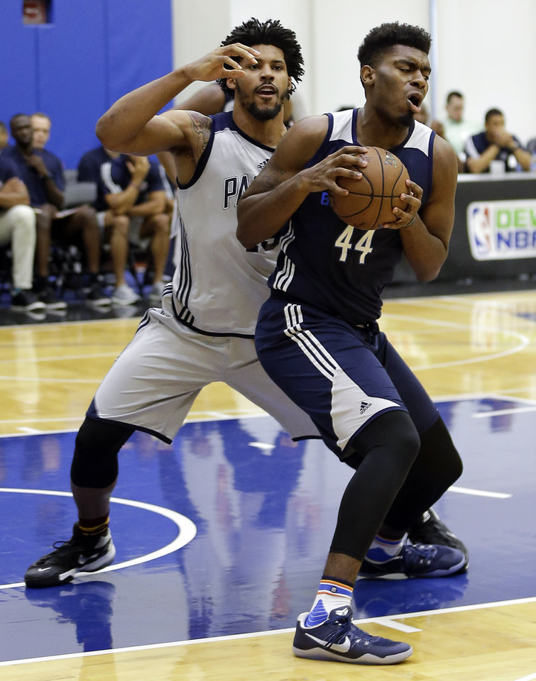 Photo - Dakari Johnson, right, played for the Thunder's Summer League team this month in Orlando. [AP PHOTO]