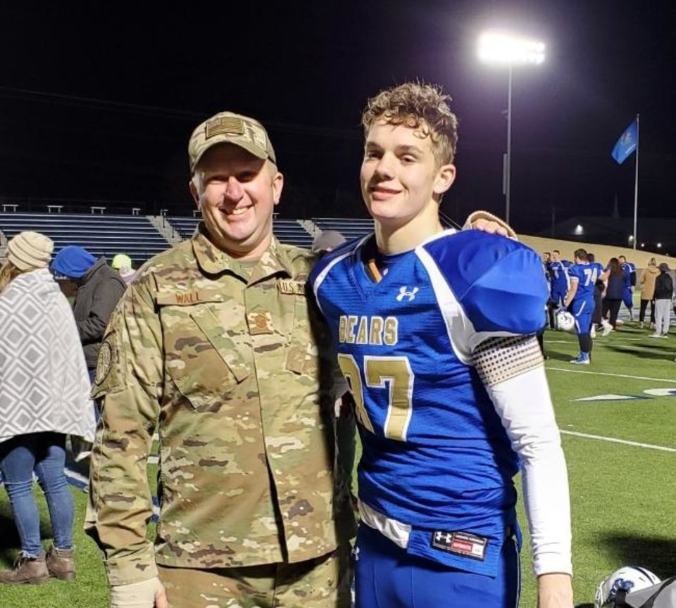 Photo -  Noble's Seth Wall poses for a photo with his dad, Doug, after a surprise ceremony Friday night announcing Doug's return from deployment. [PHOTO PROVIDED]