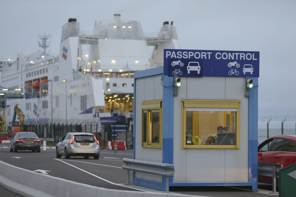 Photo -  A French custom officer works in a booth at the transit zone at the port of Ouistreham, Normandy, Thursday, Sept.12, 2019. France has trained 600 new customs officers and built extra parking lots arounds its ports to hold vehicles that will have to go through extra checks if there is no agreement ahead of Britain's exit from the EU, currently scheduled on Oct. 31. (AP Photo/David Vincent)