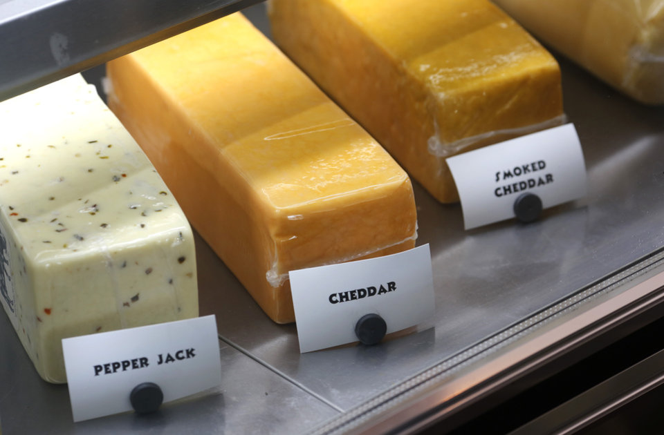 Photo -  Fresh cheeses from Scottie's Deli in Oklahoma City's Uptown 23rd district. [Photo by Jim Beckel, The Oklahoman]