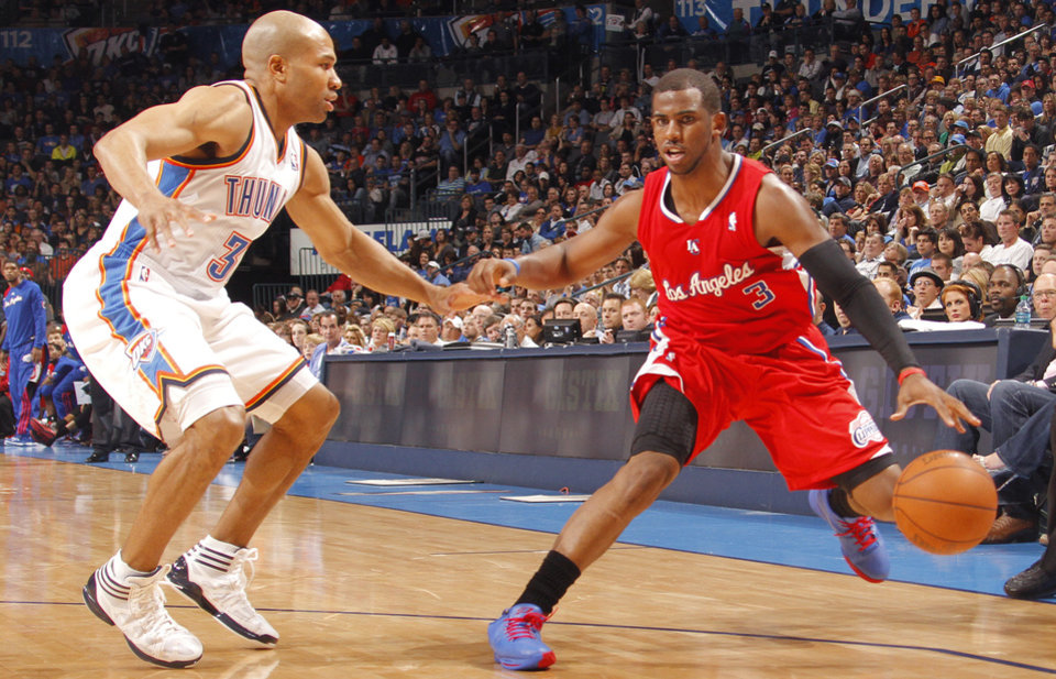 Photo - Oklahoma City's Derek Fisher (37) defends on Los Angeles Clippers point guard Chris Paul (3) during the NBA basketball game between the Oklahoma City Thunder and the Los Angeles Clippers at Chesapeake Energy Arena on Wednesday, March 21, 2012 in Oklahoma City, Okla.  Photo by Chris Landsberger, The Oklahoman