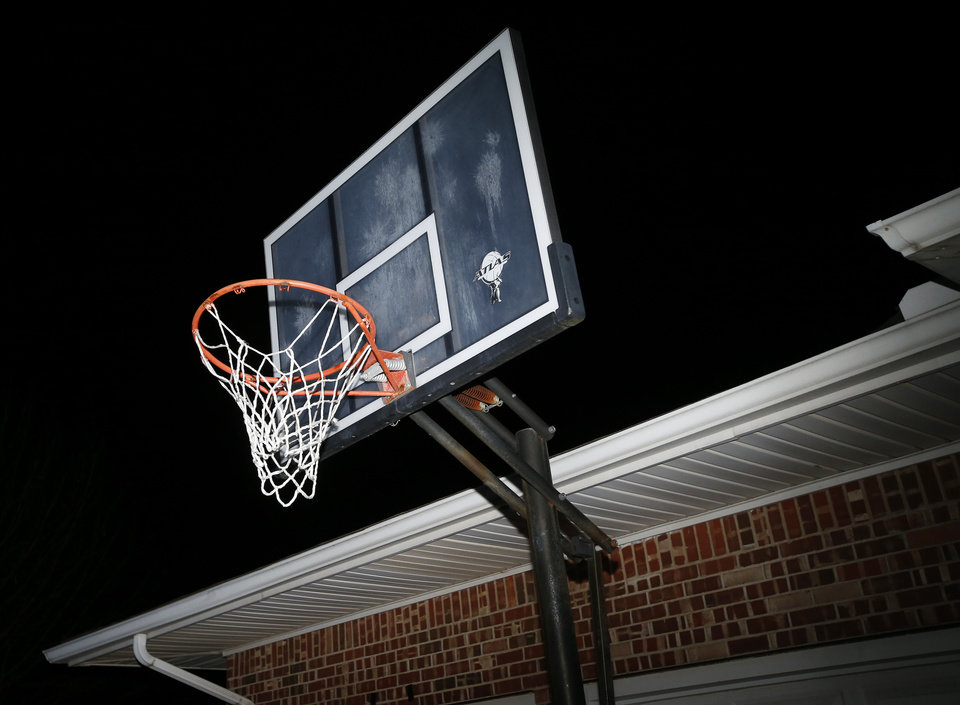 Photo - The basketball goal that Prague freshman girls basketball player Chantae Embry uses to practice at her home in Prague, Okla., Wednesday, Jan. 17, 2018. Photo by Nate Billings, The Oklahoman