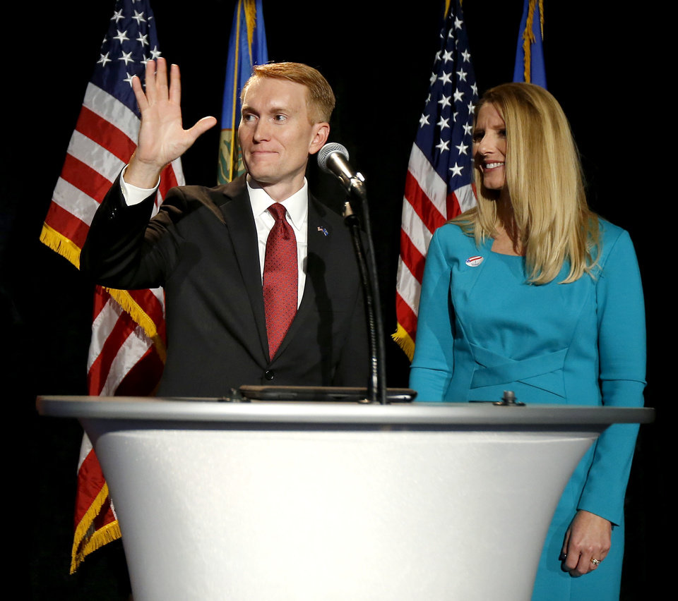 Photo - Oklahoma U.S. Sen. James Lankford speaks next to his wife Cindy as Republican Party backers gathered Tuesday night at Main Event Entertainment in northwest Oklahoma City as election returns rolled in the presidential race against Donald Trump and Democrat Hillary Clinton. Oklahomans on Tuesday also cast votes on several state ballot measures, a host of legislative contests and other local issues and offices. Photo by Bryan Terry, The Oklahoman