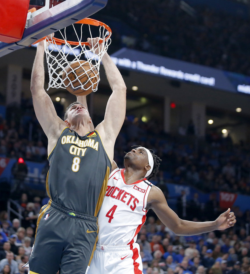 Photo - Oklahoma City's Danilo Gallinari (8) dunks beside Houston's Danuel House Jr. (4) during an NBA basketball game between the Oklahoma City Thunder and Houston Rockets at Chesapeake Energy Arena in Oklahoma City, Thursday, Jan. 9, 2020. [Bryan Terry/The Oklahoman]