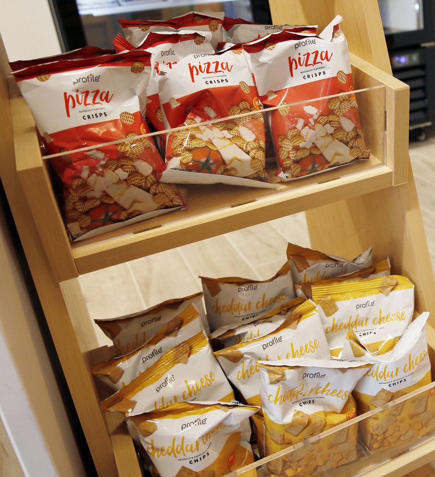 Photo -  Pizza crisps and cheddar cheese chips are for sale at Profile Sanford. [NATE BILLINGS/THE OKLAHOMAN]