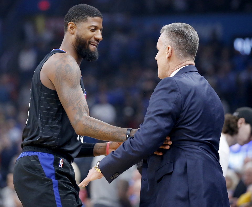 Photo - LA's Paul George talks with Oklahoma City coach Billy Donovan before an NBA basketball game between the Oklahoma City Thunder and the Los Angeles Clippers at Chesapeake Energy Arena in Oklahoma City, Tuesday, March 3, 2020. [Bryan Terry/The Oklahoman]