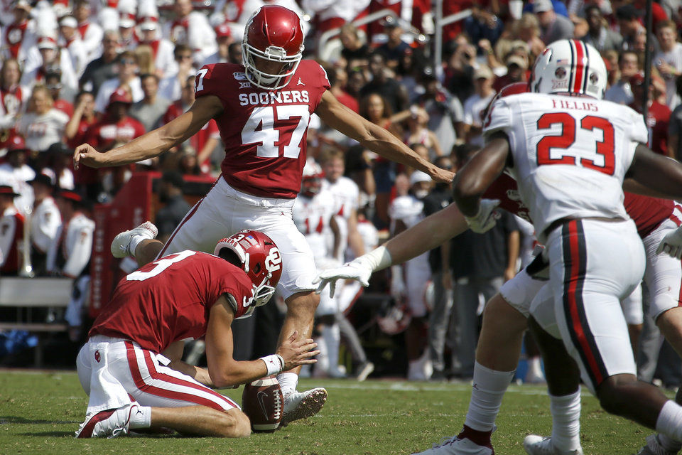 Photo - Oklahoma's Gabe Brkic (47)  kicks a field goal during a game between the Sooners and Texas Tech in September. Saturday against Kansas State, Brkic kicked a new career long field goal. [OKLAHOMAN ARCHIVES]