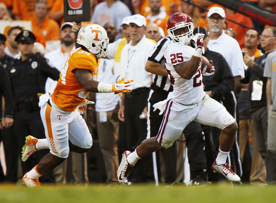 Photo - Oklahoma's Joe Mixon (25) runs from Tennessee's Darrin Kirkland Jr. (34) during the college football game between the Oklahoma Sooners (OU) and the Tennessee Volunteers at Neyland Stadium in Knoxville, Tennessee, Saturday, Sept. 12, 2015. Photo by Nate Billings, The Oklahoman
