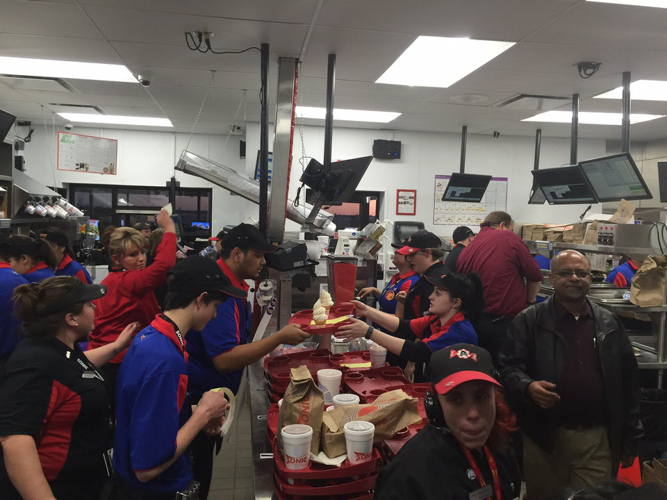 Photo -  Workers at the new Sonic and Love's co-branded location in Holcomb, Kan., are shown. [PHOTO PROVIDED]