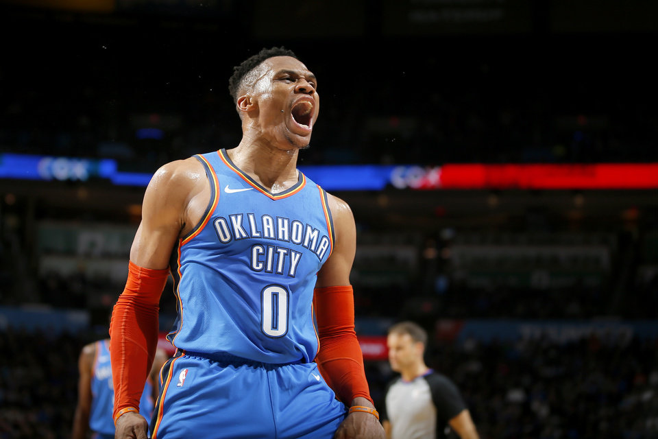 Photo - Oklahoma City's Russell Westbrook (0) celebrates after a basket during an NBA basketball game between the Oklahoma City Thunder and the Brooklyn Nets at Chesapeake Energy Arena in Oklahoma City, Wednesday, March 13, 2019. Oklahoma City won 108-96. Photo by Bryan Terry, The Oklahoman