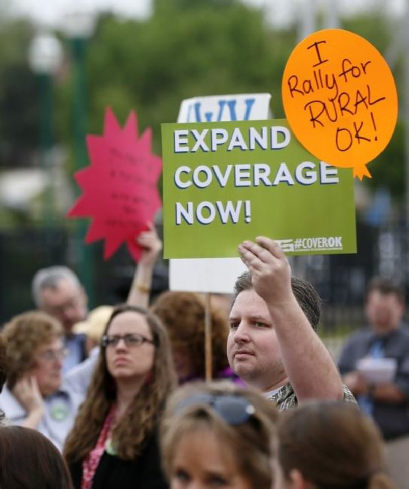 Photo -  People listen to speakers during a rally for Medicaid and health coverage expansion at the state Capitol in Oklahoma City in April. [Nate Billings/Oklahoman Archives]